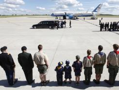 Family, scouts and military watch as a military honor guard carries the casket of former first lady Betty Ford after arriving at Gerald R. Ford International Airport in Cascade Township, Mich., on Wednesday.
