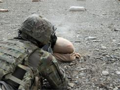 A U.S. soldier fires a rifle during training camp last Saturday.