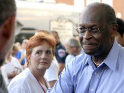Republican presidential candidate Herman Cain greets supporters at a campaign rally in Murfreesboro, Tenn., on Thursday.
