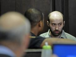 Levi Aron enters the courtroom before Judge William Miller, left, for his arraignment in Brooklyn criminal court Thursday in New York.