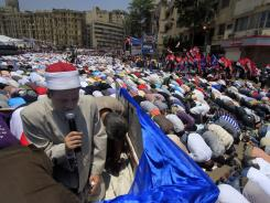 Protesters attend the Friday prayers during a demonstration in Tahrir Square in Cairo.