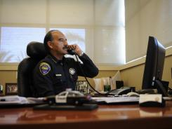Chula Vista Police Chief David Bejarano takes a phone call at his desk, seven miles from Tijuana.