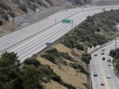 Traffic moves along Sepulveda Blvd. as a 10-mile stretch of Interstate 405 is shut down to demolish the Mulholland Drive bridge in L.A.