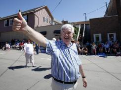 Republican presidential candidate Newt Gingrich waves while walking in a Fourth of July parade in Clear Lake, Iowa.