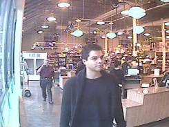 This May 23 image from surveillance video provided by Gary's Wine & Marketplace shows Mark Lugo walking in the store in Wayne, N.J.