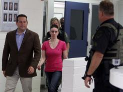 Casey Anthony, center, walks out of Orange County Jail with her attorney Jose Baez, left,  during her release Sunday.