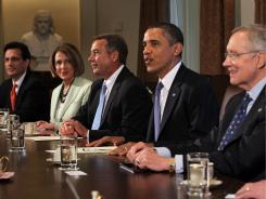President Obama meets with, from left, House Majority Leader Eric Cantor, House Minority Leader Nancy Pelosi, Speaker John Boehner and Senate Majority Leader Harry Reid, in the Cabinet Room on July 11.
