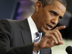 President Obama answers questions on the ongoing budget negotiations during a press conference Friday.