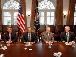 President Obama hosts  congressional leaders for talks last Thursday. A new poll shows many Americans are fed up with both sides in the ongoing debate over raising the debt ceiling.