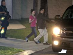 Casey Anthony, center, walks to an SUV with her lawyer Jose Baez after her release from the Orange County Jail in Orlando on Sunday.