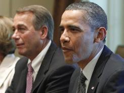 President Obama and House Speaker John Boehner participate in debt talks last Thursday.