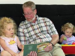 Dr. Fred Henretig, an emergency medicine specialist at Children's Hospital of Philadelphia, with granddaughters, Violet, left, and Brett, on Sunday.