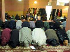 Segregated : Women pray in an area separated from men in a mosque in Minnesota.