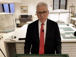 In this 2008 photo David Rubenstein poses with a 1297 Magna Carta document at the National Archives in Washington.