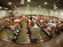 Inmates sit in crowded conditions at the California Institute for Men in Chino.