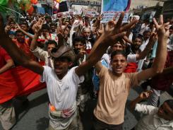 Anti-government protesters shout slogans demanding the resignation of President Ali Abdullah Saleh in Taiz, Yemen, on Thursday.