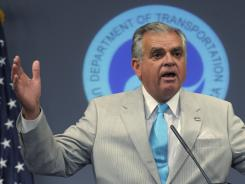 Transportation Secretary Ray LaHood talks about the possible shutdown of the FAA during a news conference in Washington on Thursday.