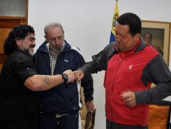 Venezuela's President Hugo Chavez, right, and Argentina's soccer legend Diego Maradona bump fists as Cuba's leader Fidel Castro looks on in Havana, Cuba, on Friday.