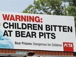 "PETA is calling bear zoos in Cherokee, N.C., ""prisons"" on a new billboard showing a little girl crying with a bloodied bandage on her hand."
