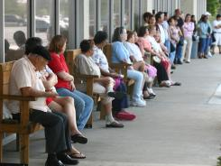 Uninsured residents wait in line to go into the Strawberry Health Center in 2007.