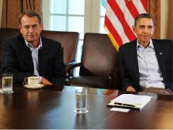 """""""No one is willing to default,"""" said House Speaker John Boehner, shown with President Obama."""
