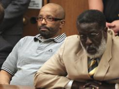 Anthony Sowell, left, sits with defense attorney Rufus Sims after he was found guilty of multiple aggravated murder charges in the slayings of 11 women in Cleveland on Friday.