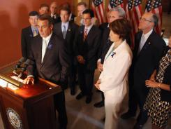 Speaker of the House John Boehner holds a news conference outside his office with House GOP members Sunday.