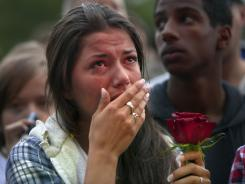 Elizabeth Amundsen, 16, gathers with thousands of people in Oslo, Norway, at a memorial vigil following Friday's twin extremist attacks.