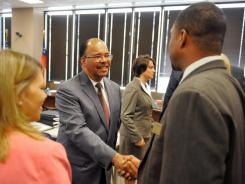Atlanta Public Schools superintendent Erroll Davis , left, is introduced to Georgia  Board of Education member Kenneth Mason after the Board of Education meeting Tuesday in Atlanta.