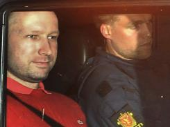 Norway's twin terror attacks suspect Anders Behring Breivik sits in an armored police vehicle after leaving the courthouse following a hearing in Oslo Monday.