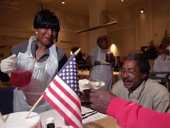 Military officials celebrate Veteran's Day at the Central Union Mission in D.C. with some of the area's disadvantaged veterans.