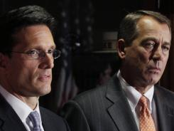 House Speaker John Boehner and House Majority Leader Eric Cantor look on during a news conference at The Republican National Committee on Capitol Hill.