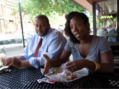 Daryl Herman and Nicole McBride talk about the debt crisis while having lunch at Al's Beef in Chicago's Little Italy neighborhood.