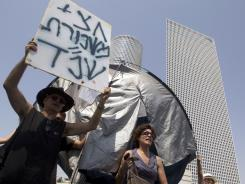Israeli demonstrators protest against rising housing prices and social inequalities in Israel.