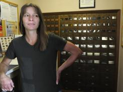 Waverly (Wash.) City Council member Kim Billington stands in the town's post office on July 11. Waverly, like many towns, is awaiting word on the fate of its post office.