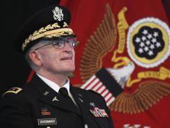 Gen. Eric B. Schoomaker listens during a flag casing ceremony at Walter Reed Army Medical Center.