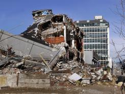 A building still sits destroyed July 8, months after a deadly quake in downtown Christchurch, New Zealand.