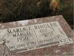 The grave of 7-year-old Maria Ridulph is seen Wednesday after her body was exhumed at Elmwood Cemetery in Sycamore, Ill.