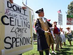 "Tea Party activists gather Wednesday on Capitol Hill for a ""Hold the Line"" rally. With the debt-limit impasse reaching a critical juncture, activists from all sides of the debate are reaching out to members of Congress."