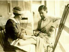 A nurse at Walter Reed massages the leg of an amputee from World War I in preparation for the attachment of a prosthetic limb.