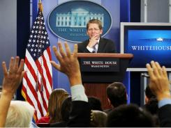 White House spokesman Jay Carney briefs reporters on crisis Wednesday.
