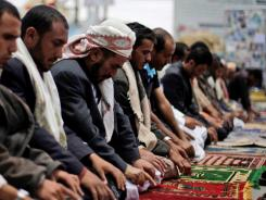 Protesters stop for noon prayers during a demonstration demanding the resignation of President Ali Abdullah Saleh in Sanaa, Yemen, on Tuesday.