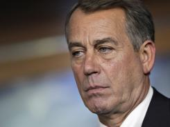 House Speaker John Boehner pauses during a news conference Thursday while talking about the debt crisis showdown.