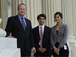 "Rep. Polis says it's an ""eye-opening experience"" to have interns Israeli Rotem Gabay, right, and Samer Anabtawi, a Palestinian, working in his office."