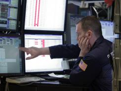 Stock floor : William Krumm works at the New York Stock Exchange. Last year, Congress passed the Dodd-Frank Act aimed at protecting consumers and reforming Wall Street.