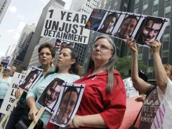Laura Fattal, left, Cindy Hickey, center, and Nora Shourd, mothers of three American hikers jailed in Iran, participate in a demonstration outside Iran's mission to the United Nations in New York in 2010.