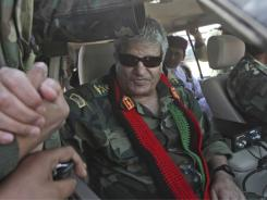 Former Libyan rebel leader Abdel-Fattah Younis, shown here greeting supporters earlier this year, was killed by gunmen Thursday.