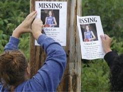 Missing posters are hung for 11-year-old Celina Cass in Colebrook, N.H., Wednesday.
