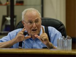 Laguna Woods, Calif., City Council member Bob Ring asks a question Thursday about an emergency ordinance authorizing the discharge of firearms by trained wildlife depredation professionals in order to control a coyote infestation in the city limits.
