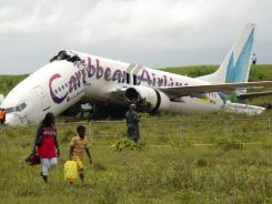 The broken fuselage of a Caribbean Airlines' Boeing 737-800 is seen after it crashed at the end of the runway at Cheddi Jagan International Airport in Guyana Saturday.